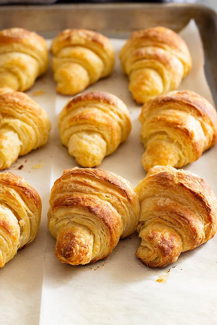 These flaky homemade Crescent rolls are much easier to make than croissants and go great with any meal! #homemaderolls #crescentrolls