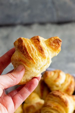 These tender and flaky homemade Crescent Rolls are perfect for your holiday meals!! They are much easier to make than croissants and so buttery! #homemaderolls #crescentrolls