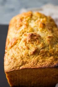 Beer Bread is a simple quick bread that is flavored with beer. It's really easy to make and goes great with any meal!
