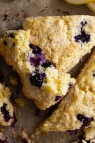 A scone broke open to show the blueberries.