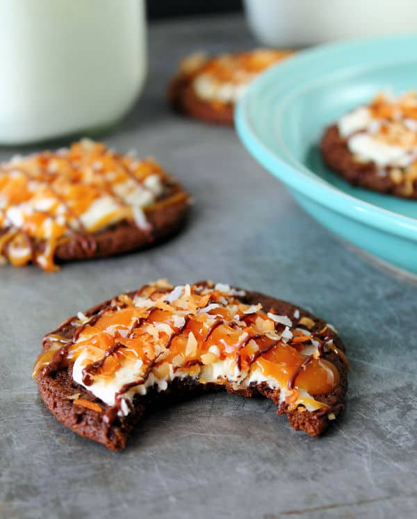 Chocolate Samoa Cookies have a chewy chocolate base topped with caramel, toasted coconut and drizzled with chocolate! These disappear fast! | countrysidecravings.com