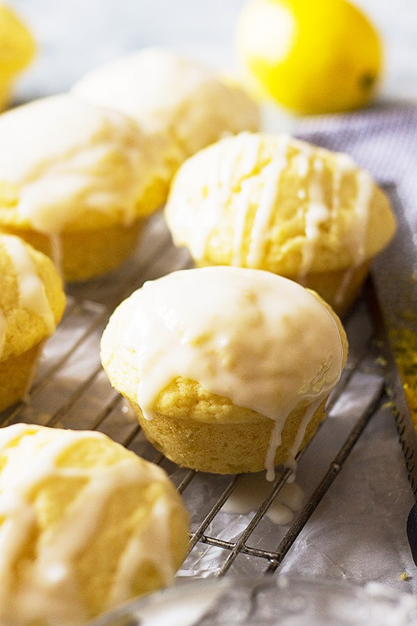 These Lemon Muffins are a great addition to your breakfast table! They are full of bright lemon flavor and topped with a lovely glaze!