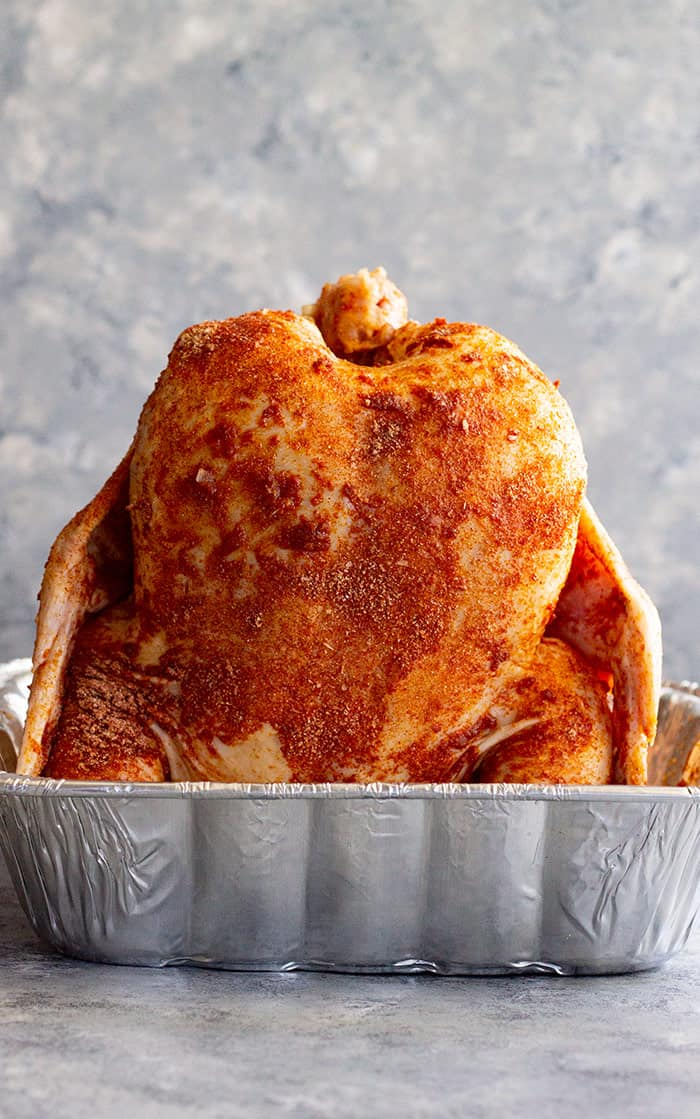 Beer can chicken sprinkled liberally with beer can chicken rub and ready for the grill or oven!