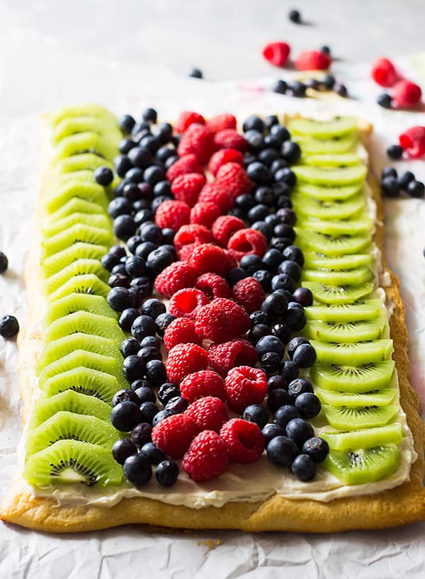 This Easy Fruit Pizza is an easy recipe thanks to store bought crescent dough. It's then topped with sweetened cream cheese and loads of juicy fruit!