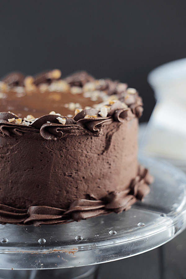 A dark chocolate cake with rich chocolate frosting, pecans and caramel, what's not to love?