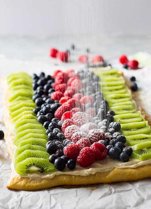 This Easy Fruit Pizza is a quick and simple recipe. It features crescent dough, sweetened cream cheese and lots of juicy fruit!