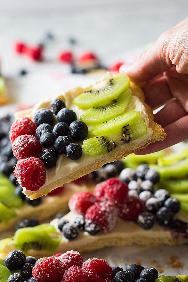 This Easy Fruit Pizza will make a great appetizer or quick dessert for any party you may have! It's topped with sweetened cream cheese and scrumptious fruit!