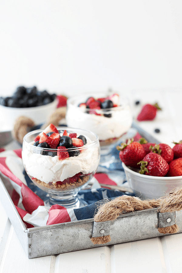 This Healthier Berry Cheesecake Parfait is a quick and easy dessert that's perfect for the 4th of July!! | Countryside Cravings