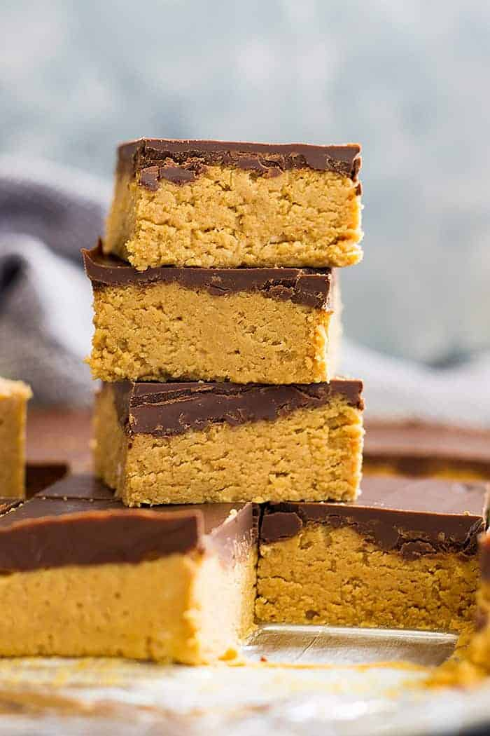 No bake chocolate peanut butter bars stacked on top of each other in a tall tower.