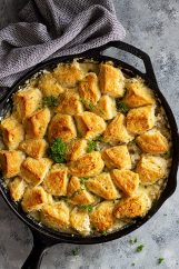 Top down view of a large pan of biscuit and gravy casserole.
