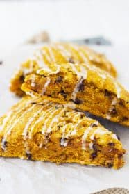 These Pumpkin Chocolate Chip Scones are filled with a wonderful pumpkin flavor, packed with chocolate chips and drizzles with an easy vanilla icing. | Countryside Cravings