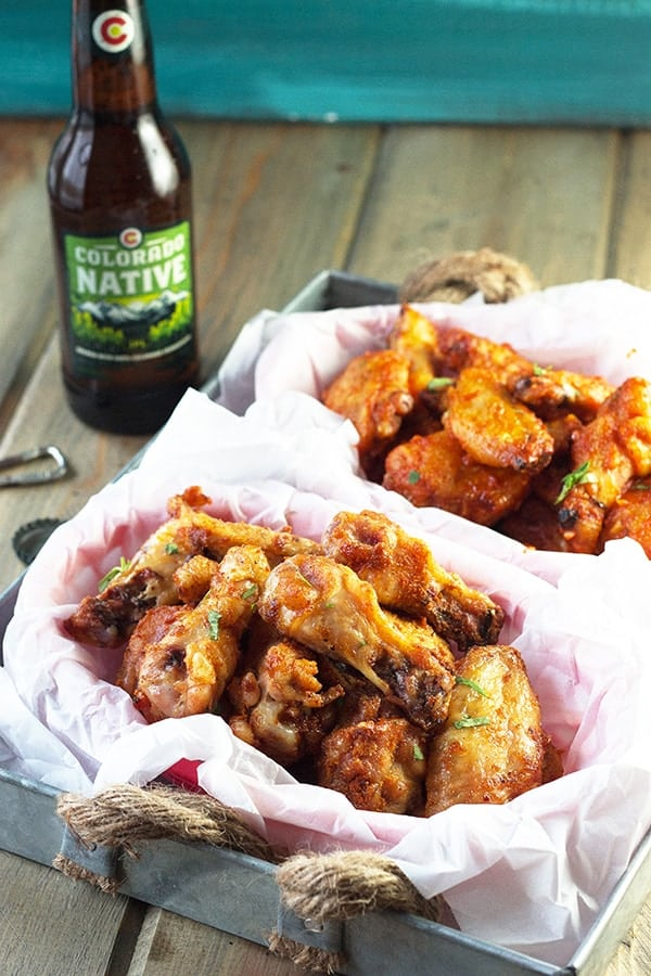 Baked Garlic Sriracha Wings- these wings are baked to crispy perfection then either coated in a garlic sriracha dry rub or sauce! | countrysidecravings.com
