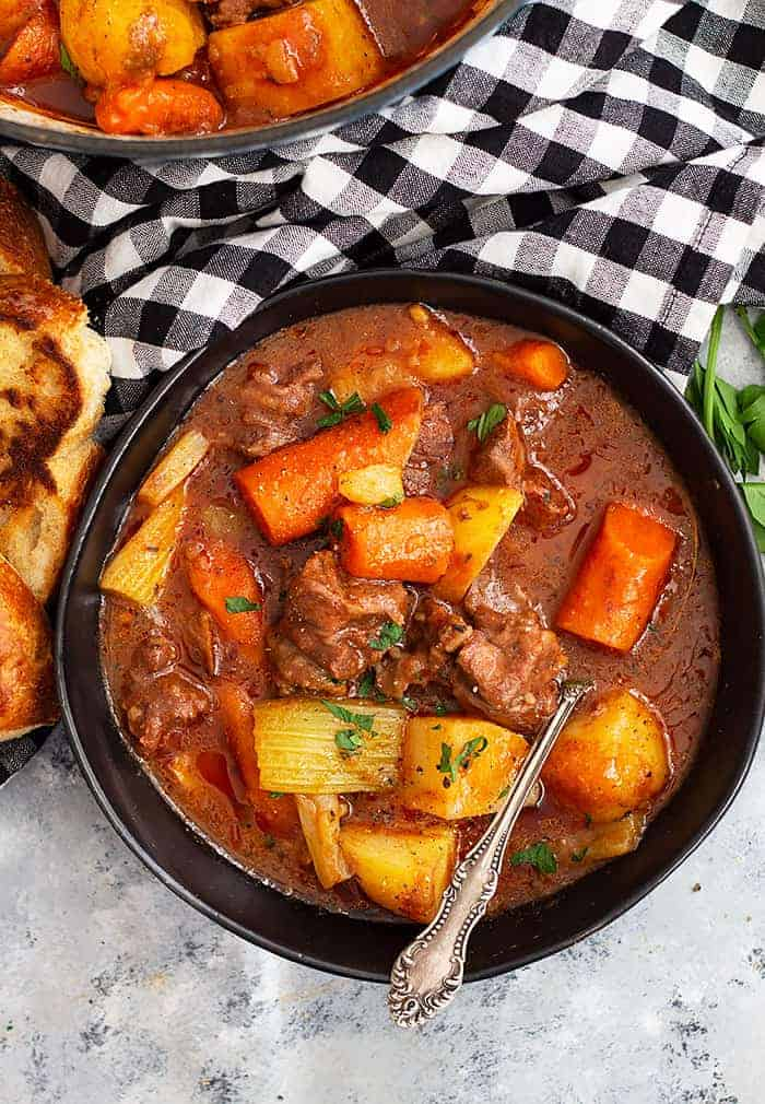 This Hearty Beef Stew is comfort food to the max! It's and easy beef stew recipe that's filled with fall apart tender beef in a wonderful hearty sauce. #beef #beefstew #easyrecipe #slowcooker