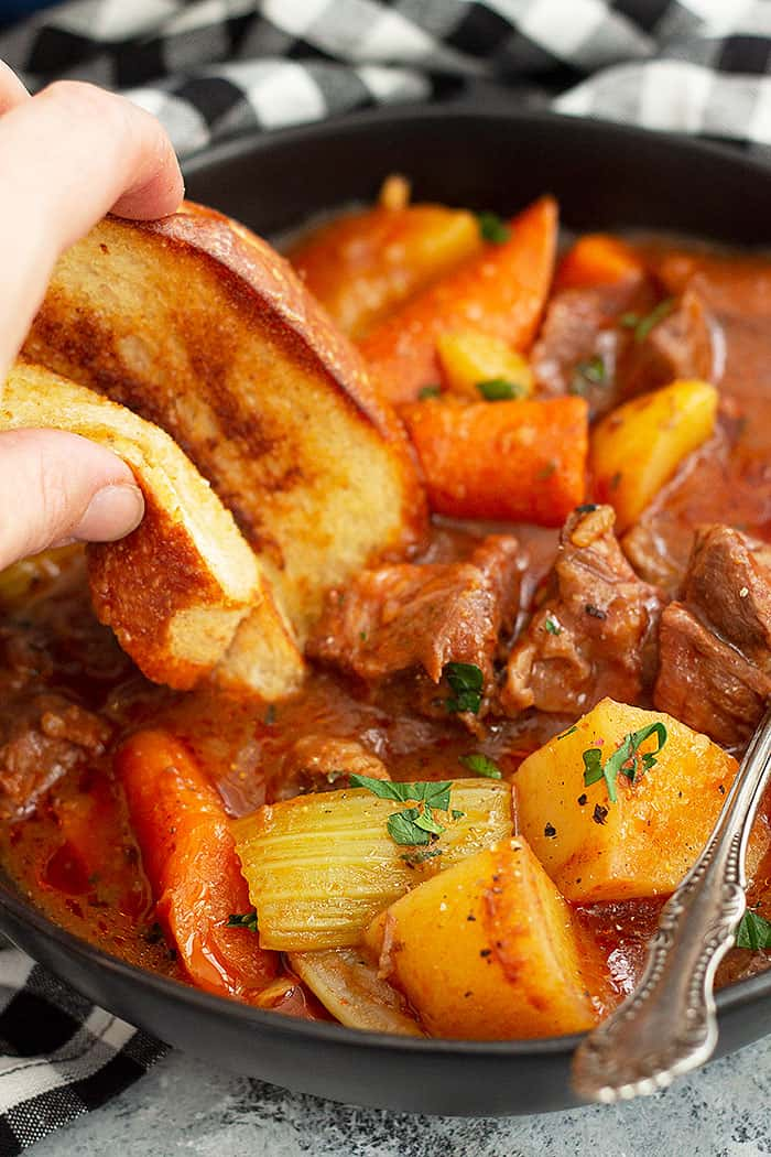 This Hearty Beef Stew is a classic beef stew recipe. It's full of fall apart tender beef in a hearty gravy. Oven and slow cooker instructions included. #easyrecipe #beef #beefstew #slowcooker