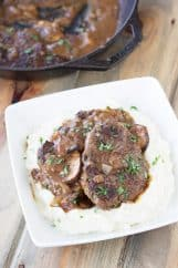 Salisbury Steak with Mushrooms and Creamy Mashed Potaotes- This is classic comfort food, but I promise it tastes way better than frozen or what you may remember from your school cafeteria! Serve it with the creamy mashed potatoes and you have a wonderfully satisfying meal!   Countryside Cravings