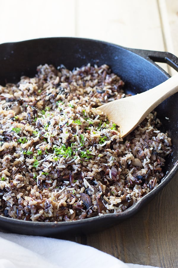 Cheesy Wild Rice with Mushrooms- this is a great fall side dish full of flavor from Parmesan cheese, wild rice cooked in chicken broth and super tasty sauted mushrooms! | countrysidecravings.com