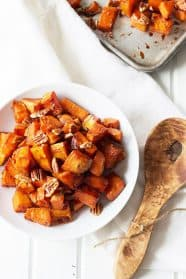 Maple Roasted Sweet Potatoes- these are lightly sweetened with maple syrup, spiced with cinnamon and have an optional crunch from pecans, YUM! | countrysidecravings.com