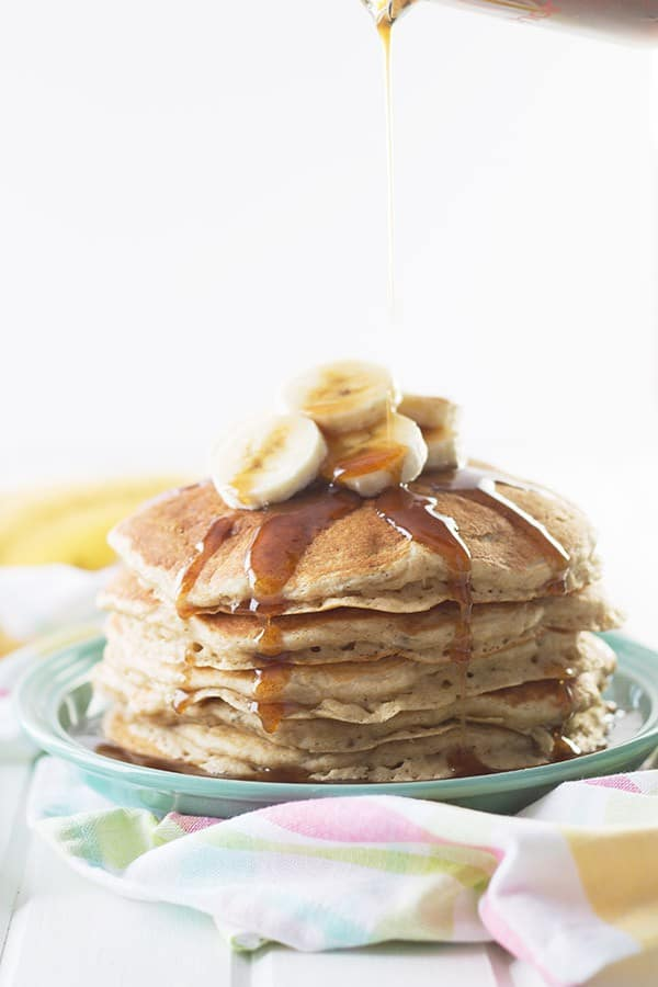 Banana Pancakes with Cinnamon Caramel Syrup -these pancakes are light, fluffy and full of banana flavor. Drizzle with the easy cinnamon caramel syrup and you have an extra special breakfast! | countrysidecravings.com
