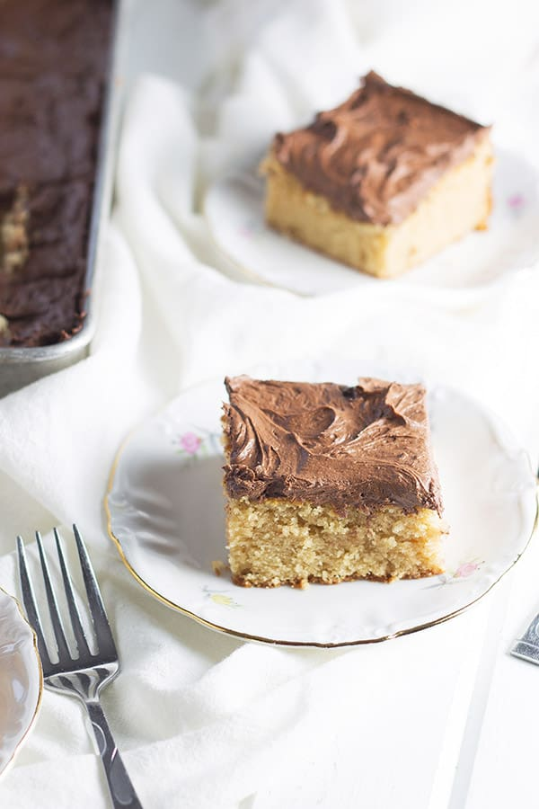 Peanut Butter Cake with Chocolate Frosting- this is an easy cake that is full of peanut butter flavor and topped with a rich and creamy chocolate frosting!   countrysidecravings.com