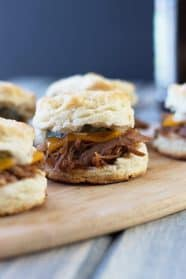 BBQ Pulled Pork Biscuit Sliders -perfect little sandwiches with smokey pulled pork, melted cheddar and Dijon mustard. | countrysidecravings.com