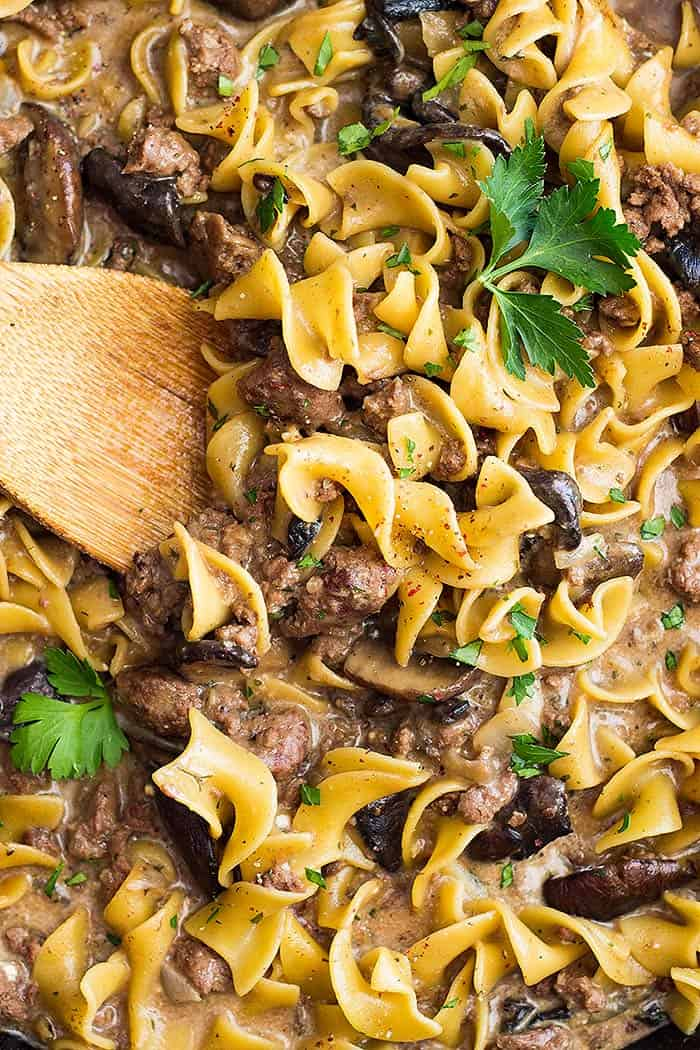 Up close picture of one pot hamburger stroganoff and a spoon.