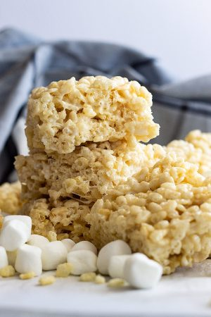 These Chewy Rice Krispie Treats will rival any store bought! Soft and chewy and the perfect base for any add-ins you may want! #ricekrispietreats #chewyricekrispietreats