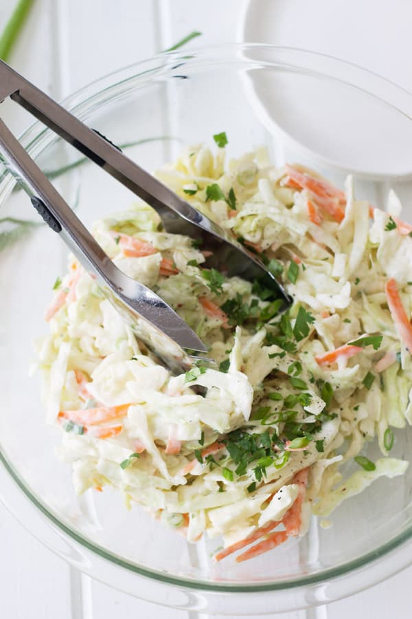 Creamy Coleslaw is a simple salad that can be made in 15 minutes or less. | www.countrysidecravings.com