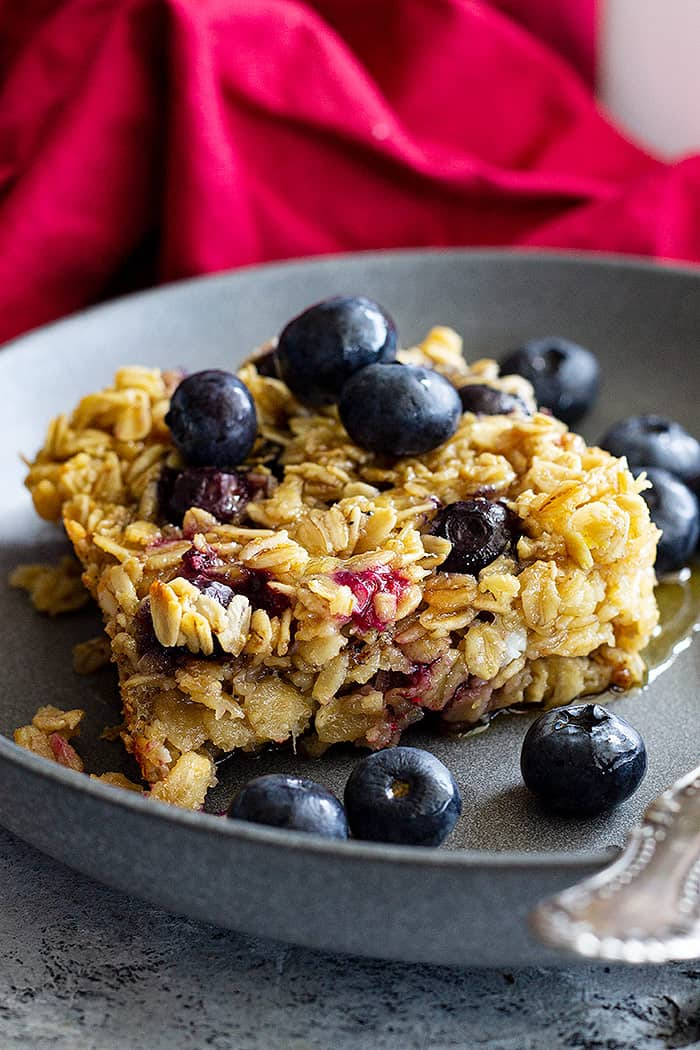 A dish of baked oatmeal topped with fresh blueberries.