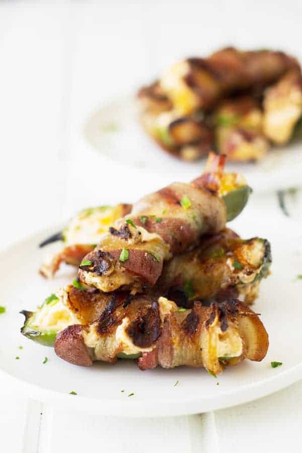 Grilled Jalapeno Poppers are filled with a creamy cheese mixture, wrapped in smokey bacon, then grilled until the cheese becomes nice and gooey! | www.countrysidecravings.com