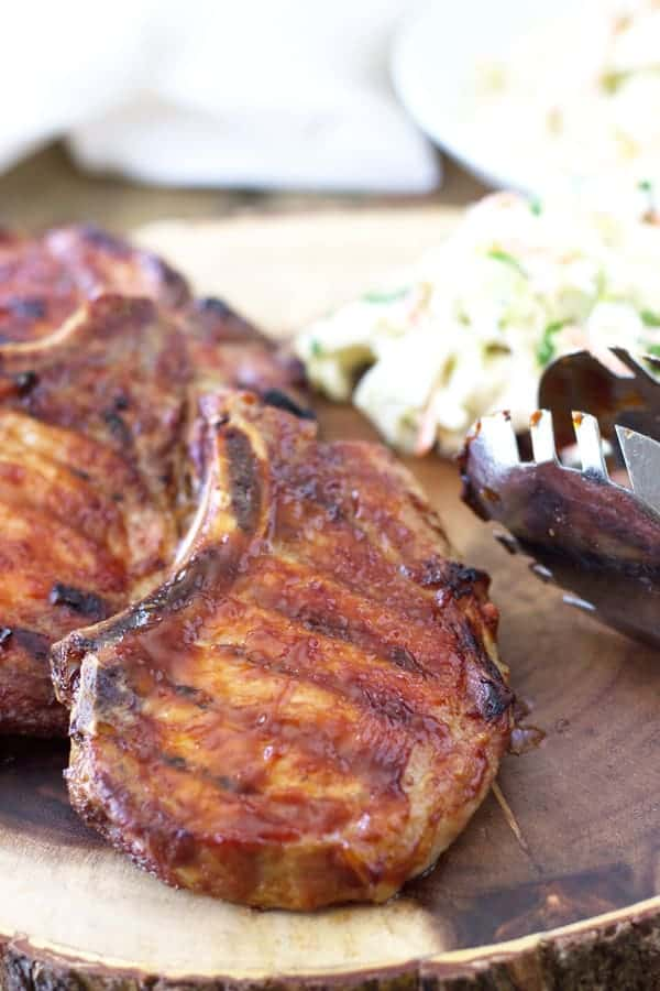 Quick Smoked BBQ Pork Chops are an easy way to get that great smoke flavor without the long smoking process. | www.countrysidecravings.com