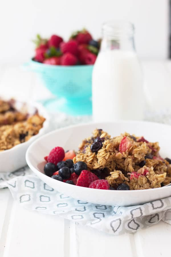 Triple Berry Baked Oatmeal is an easy and healthy way to start off the day. Full of fresh fruit and heart healthy oats! | www.countrysidecravings.com