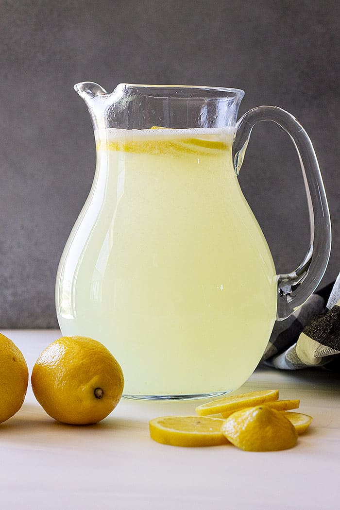 A pitcher of freshly made lemonade.