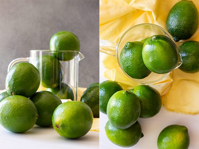 Limes scattered with a yellow napkin in the background.