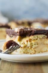 This Twix Icebox Cake is an easy and decadent no-bake cake. Made with homemade pudding, shortbread cookies, caramel and chocolate! | www.countrysidecravings.com