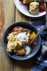 Blueberry Peach Cobbler -an easy recipe made with fresh peaches and blueberries baked beneath a fluffy biscuit topping! | www.countrysidecravings.com