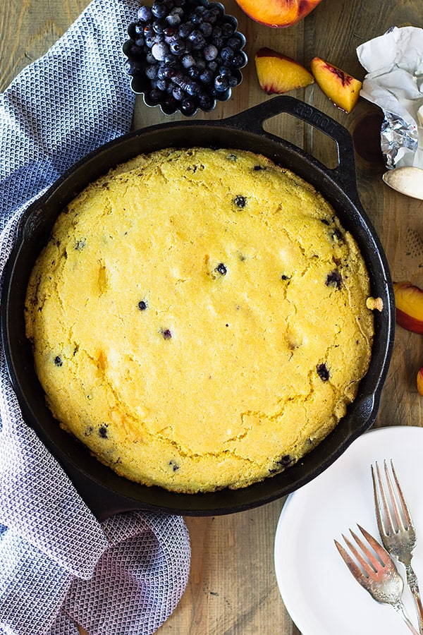 Blueberry Peach Cornbread made with buttermilk, studded with fresh blueberries and peaches will be your new favorite breakfast treat! | www.countrysidecravings.com