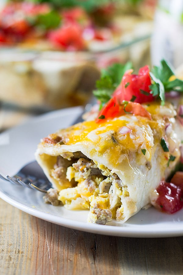Breakfast Enchiladas are filled with scrambled eggs, sausage, green chilies and cheese! Perfect for weekend breakfast or brunch! | www.countrysidecravings.com