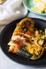 Easy Sheet Pan Mexican Chicken and Vegetables made with fresh corn, zucchini, onion, seasoned to perfection and done in 30 minutes!   www.countrysidecravings.com