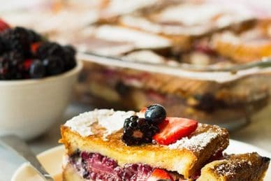 Triple Berry French Toast Casserole -an easy yet impressive breakfast casserole. Layered with thick texas toast, cream cheese, fresh berries and an egg custard! | www.countrysidecravings.com