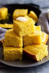 This Buttermilk Cornbread recipe is the best cornbread ever!! Choose to make it sweet or savory by adjusting the sugar. It has a tender moist crumb and is perfect drizzled with honey! #cornbread #easyrecipe #sweetcornbread