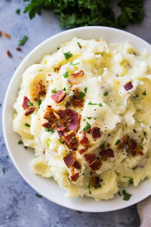 Bacon Mashed Potatoes are creamy, fluffy and full of flavor! Studded with crispy bacon, green onions and made ultra decadent with a little cream cheese.   www.countrysidecravings.com