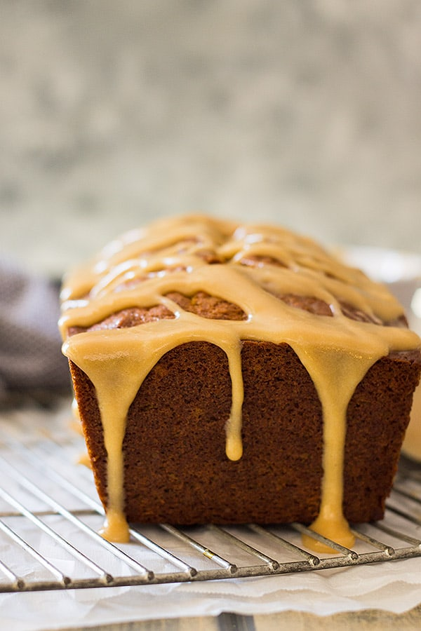 This Pumpkin Bread with Cream Cheese Caramel Icing is super easy to make! It's moist, tender, full of pumpkin and spice. But the best part is the super easy cream cheese caramel icing!! | www.countrysidecravings.com