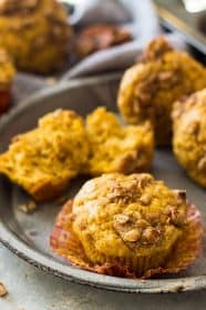 These Pumpkin Steusel Muffins are the perfect fall breakfast or snack! They are perfectly moist, full of pumpkin flavor, spiced perfectly and topped with a crunchy streusel topping! | www.countrysidecravings.com