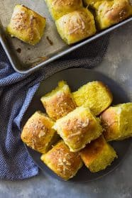 These Savory Pumpkin Rolls will be a great addition to your dinner table. Fluffy light biscuits made with pumpkin, rosemary and Parmesan cheese.   www.countrysidecravings.com