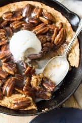 This easy Skillet Blondie with Bourbon Caramel Pecans is thick and chewy, studded with pecans, then topped with the most luscious bourbon caramel! | www.countrysidecravings.com