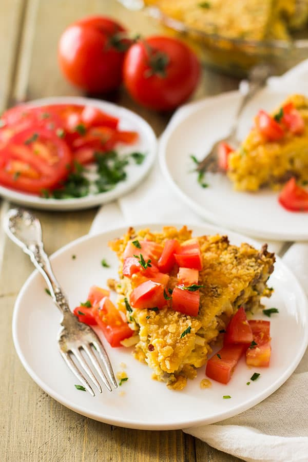 This Hashbrown Sausage Breakfast Pie is filled to the top with breakfast sausage, hashbrowns, 2 cheeses, garlic and a special topping! | www.countrysidecravings.com