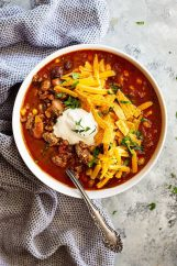 This Easy Taco Soup is big on flavor, hearty, and only takes 30 minutes to make! Or make it in the slow cooker and come home to a delicious meal! #soup #easy #healthy #taco