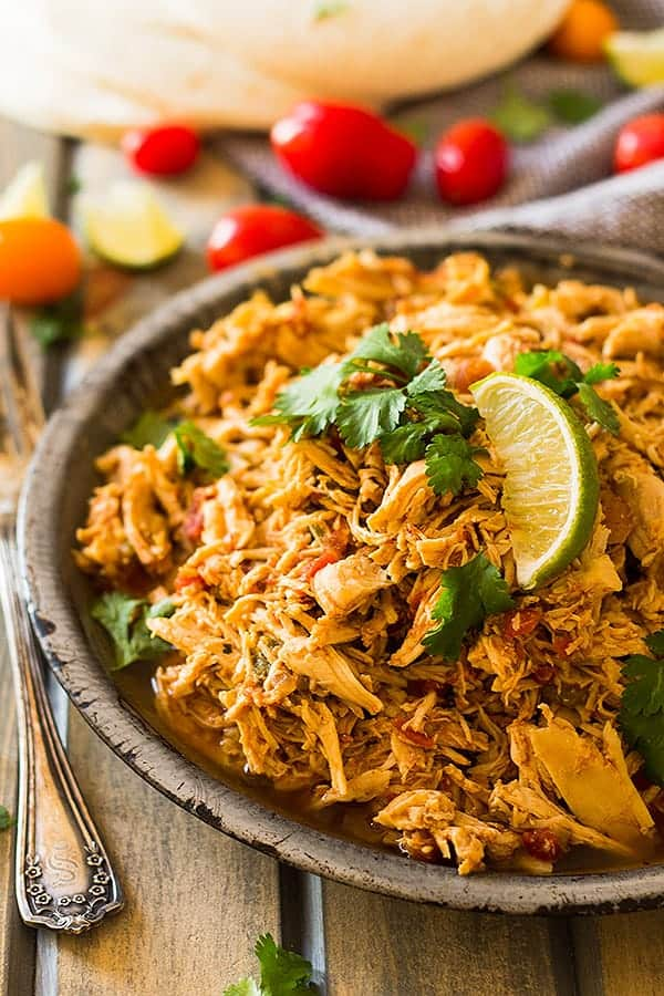This easy Slow Cooker Shredded Mexican Chicken is a great base recipe to use for tacos, enchiladas, nachos, burritos, salads or just serve it over rice. | www.countrysidecravings.com