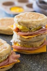 This Freezer Breakfast Ham Egg and Cheese sandwich is a healthier alternative to that Egg McMuffin! They are easy to make and are a great for breakfast on the go! | www.countrysidecravings.com