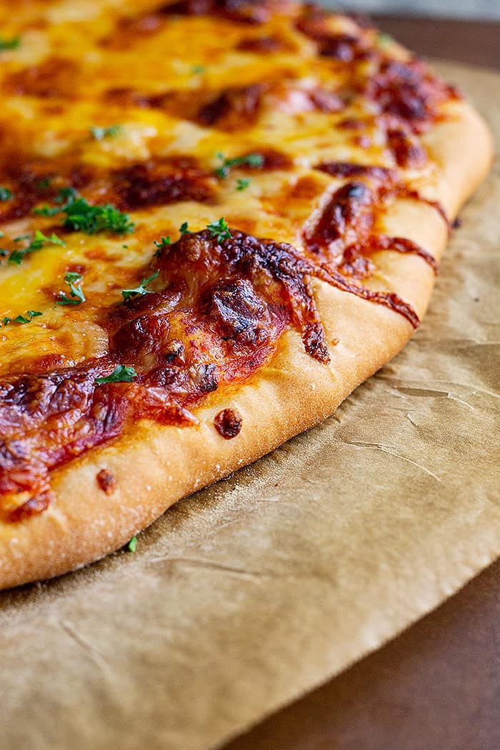 Close up of pizza hot from the oven.